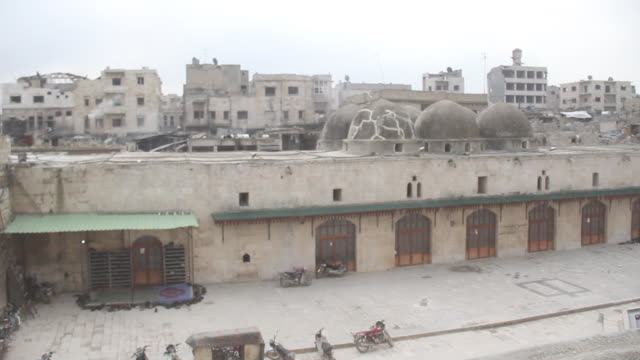 pan-right of the courtyard of the 12th century ayyubid-era great mosque of maarat al-numan. the mosque was badly damaged during the civil war. - circa 12th century stock videos & royalty-free footage