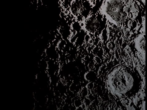 pan-right of the craters covering the surface of the moon. - meteor crater stock videos & royalty-free footage