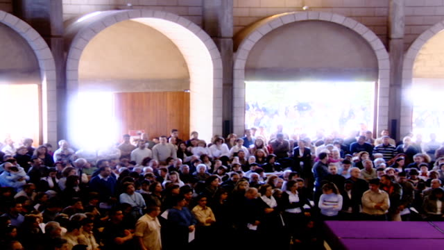 pan-right view of a congregation attending mass in the church of the maronite monastery of saint maron in annaya. - christianity stock videos & royalty-free footage