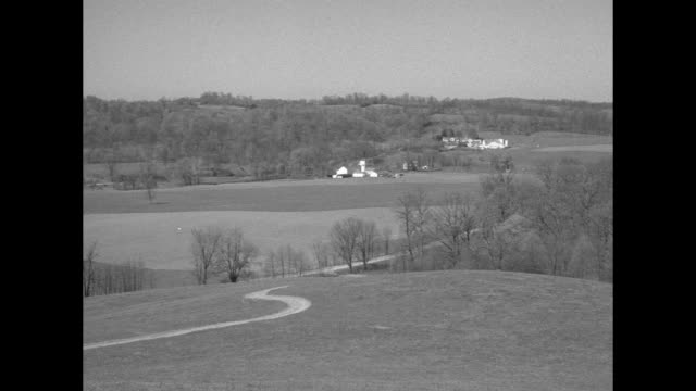 pans of author/conservationist louis bromfield's malabar farm, with house and outbuildings in the far distance with a curving dirt road winding... - boxer dog stock videos & royalty-free footage