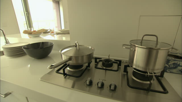 MS Pans on stove of model home, Beijing, China