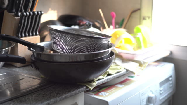 pans waiting to be washed on the kitchen counter - hygiene stock videos & royalty-free footage