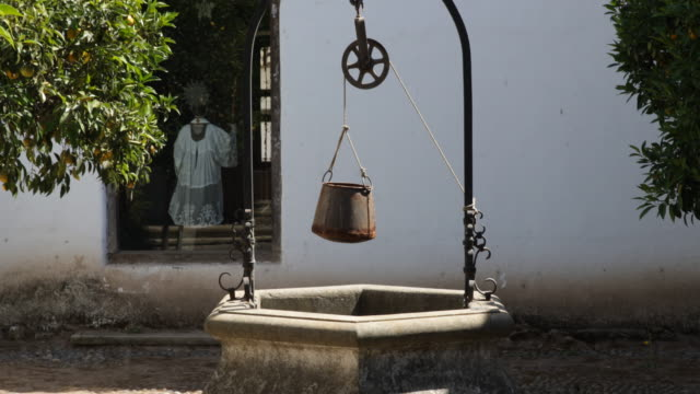 panshot in a backyard in a jesuit church in calera de tango, chile. in the middle of the backyard stands an old water fountain with a cross on top,... - religious dress stock videos & royalty-free footage