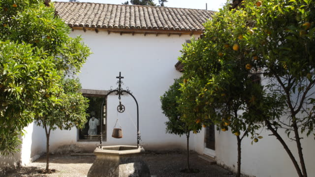 panshot in a backyard in calera de tango chile in the middle of the backyard stands an old water fountain with a cross on top surrounded by lemon... - religious dress stock videos & royalty-free footage