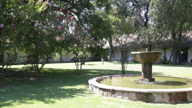 panshot of the blooming garden with a running water fountain in calera de tango chile calera de tango shows the great jesuit mission art like the... - jesuit stock videos and b-roll footage