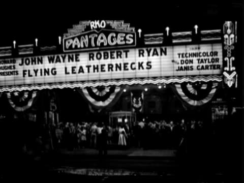 pantages theater facade and marquee during movie premiere for the flying leathernecks los angeles california night automobile traffic passes in fg... - film premiere stock videos & royalty-free footage