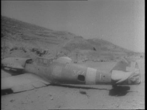 Pantelleria beats off surprise dive bombing raid by Nazi Stukas / map of Pantelleria / American soldiers march through bombed out landscape /...