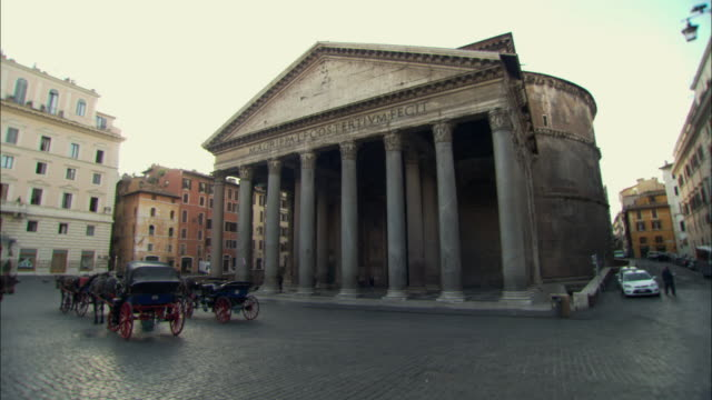 ws pantheon with horse-drawn carriages in foreground / rome, italy - pantheon rome stock videos and b-roll footage