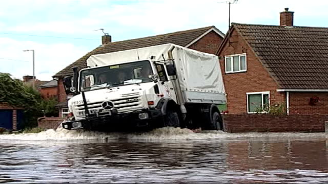 pantomime accused of being in breach of geneva convention location red cross vehicle along through flooded area and red cross workers handing out... - red cross stock videos & royalty-free footage