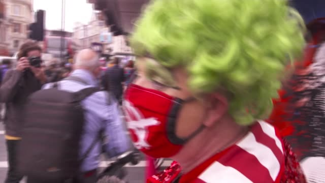 pantomime dames march to highlight plight of theatre workers; england: london: ext gary bridgens interview as marching along sot - itv london lunchtime news stock videos & royalty-free footage