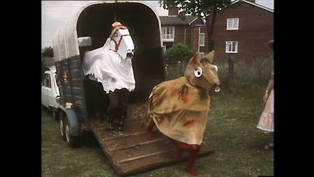 ws pantomime horses unload from horsebox; 1980 - two animals stock videos & royalty-free footage