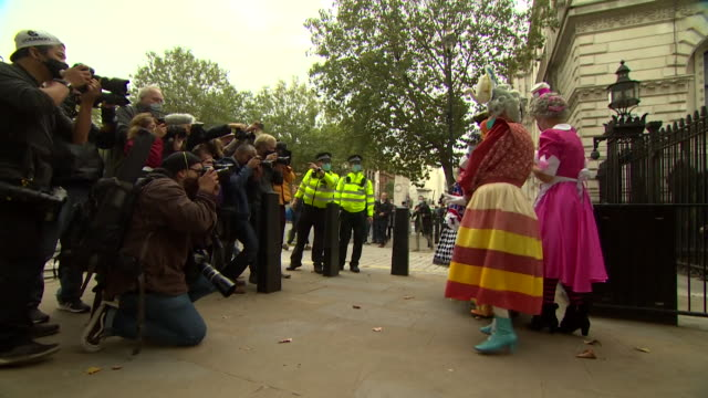 pantomine dames pose outside downing street as they protest over the damage and lack of help to the theatre industry caused by coronavirus... - marching stock videos & royalty-free footage
