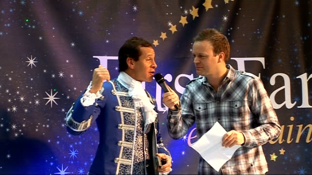 panto stars take part in photocall; steve guttenberg talking to compere about appearing in panto sot - スティーヴ グッテンバーグ点の映像素材/bロール