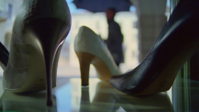 ms panview of sandel in store / bonferraro di sorga, verona, italy - footwear stock videos & royalty-free footage