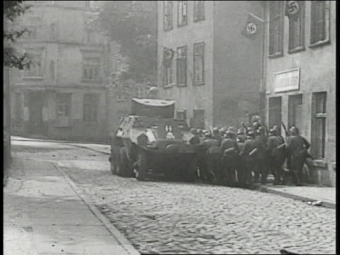 panzer tank moving forward passing danzig soldiers use panzerkampfwagen as cover explosion outside post office nazi soldier spraying accelerant ext... - moving office stock videos and b-roll footage