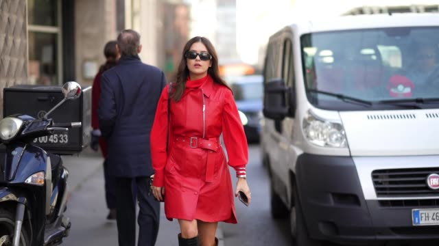 paola alberdi wears sunglasses a red leather dress a belt black leather crocodile pattern high pointy boots a bag outside sportmax during milan... - boot stock videos & royalty-free footage
