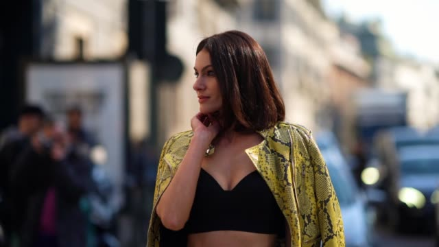 paola turani wears black bras, yellow snake pattern printed jacket, a leather skirt, outside ermanno scervino, during milan fashion week fall/winter... - bra stock videos & royalty-free footage