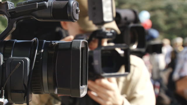 paparazzi at work - media occupation stock videos & royalty-free footage