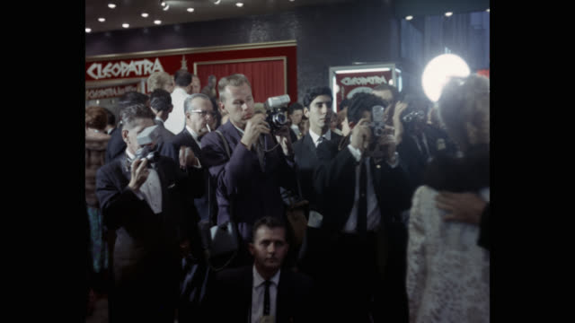 paparazzi taking pictures of actors and actresses as they enter the theater. - film premiere stock videos & royalty-free footage