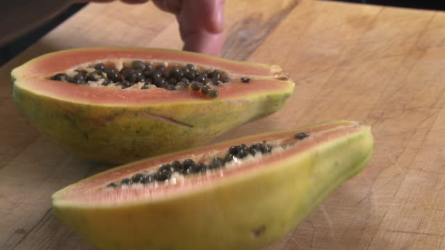 a papaya is split in half and put in a blender - papaya stock videos & royalty-free footage