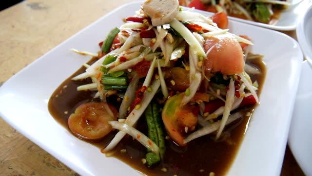 papaya salad and thai traditional food - thai food stock videos and b-roll footage