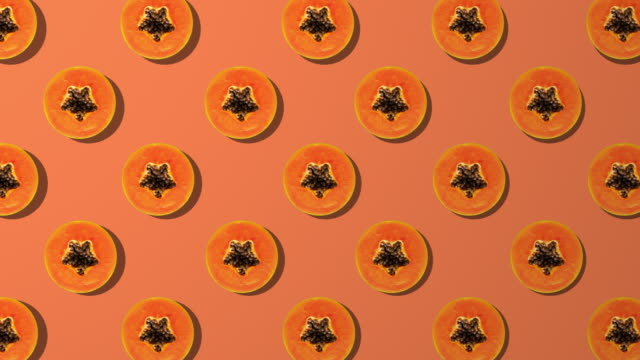 papaya slice spinning pattern on orange background - studio shot stock videos & royalty-free footage