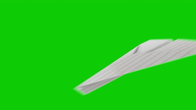 paper airplane isolated on green chromakey - carta video stock e b–roll
