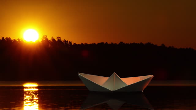 paper boat at sunset - nostalgia stock videos & royalty-free footage