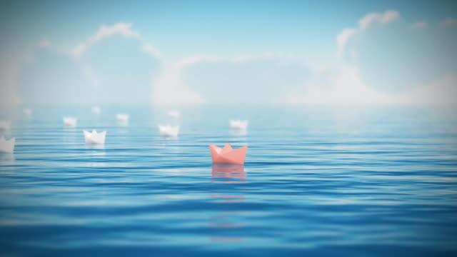 Papier-Boote schwimmende.