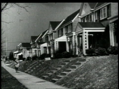 stockvideo's en b-roll-footage met 1948 ls paper boy on bicycle delivering newspaper to houses on a residential street / united states - alleen één tienerjongen