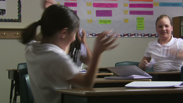 paper fight in class - see other clips from this shoot 1148 stock videos & royalty-free footage