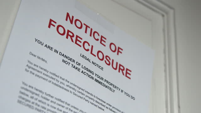 paper foreclosure notice taped to the front door of a home in a residential suburban neighborhood - western script stock videos & royalty-free footage