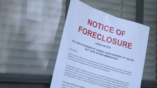 paper foreclosure notice taped to the front storm door of a home in a residential suburban neighborhood - western script stock videos & royalty-free footage