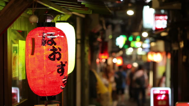 ms paper lantern hanging on narrow shopping street at night / tokyo, japan - lantern stock videos & royalty-free footage