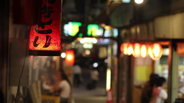 ms paper lantern hanging on narrow shopping street at night / tokyo, japan - paper lantern stock videos and b-roll footage
