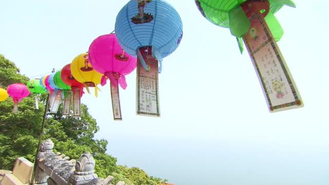 ms pan paper lanterns and people praying at buddha birthday / gangwon-do, south korea - buddha's birthday stock videos and b-roll footage