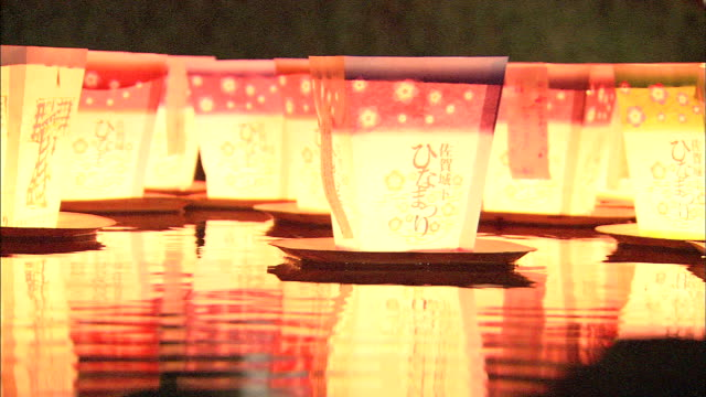 paper lanterns float on a river. - lantern stock videos & royalty-free footage