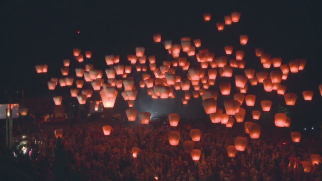 Paper lanterns float skyward during a festival in Pingshi, Taipei.