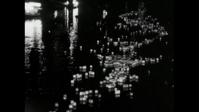 zo paper lanterns floating on river in hiroshima; 1966 - memorial event stock videos & royalty-free footage