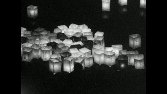 paper lanterns on river and illuminated atomic bomb dome; 1966 - weapons of mass destruction stock videos & royalty-free footage