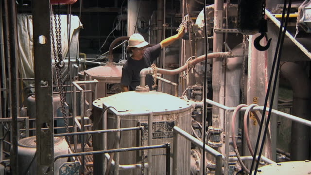 ws pan tu td paper mill worker inspects paper making machine where impurities from recycled paper source are filtered out / manistique, michigan, usa - paper mill stock videos & royalty-free footage