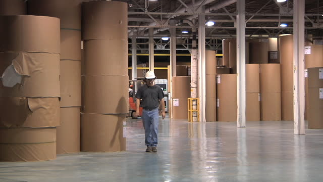 ws paper mill worker walking through warehouse / manistique, michigan, usa - only mature men stock videos & royalty-free footage