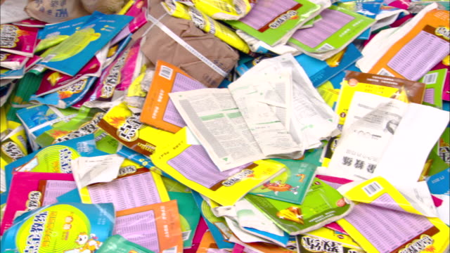 cu pan paper pamphlets sitting in heaps at recycling center, beijing, beijing, china - brochure stock videos and b-roll footage