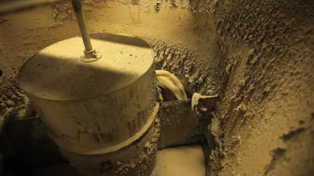 ms paper pulp processing in splitter tank at paper mill / manistique, michigan, usa - ドラム容器点の映像素材/bロール