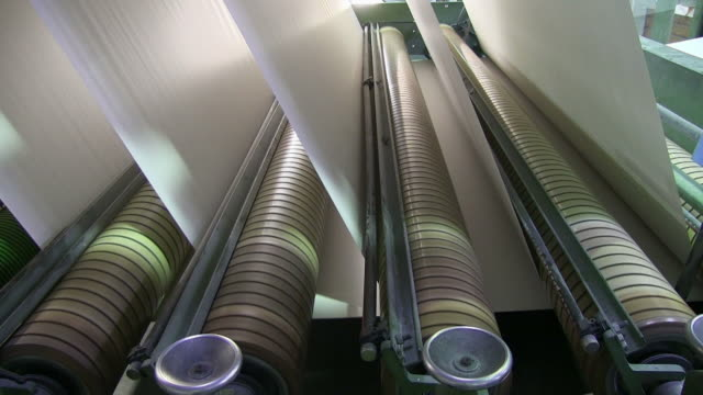ms paper rolls at cutting machine in paper mill / glueckstadt, schleswig-holstein, germany - pulp stock videos & royalty-free footage