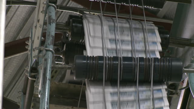 cu paper running through printer's rollers at printing plant, san francisco, california, usa / audio - journalismus stock-videos und b-roll-filmmaterial