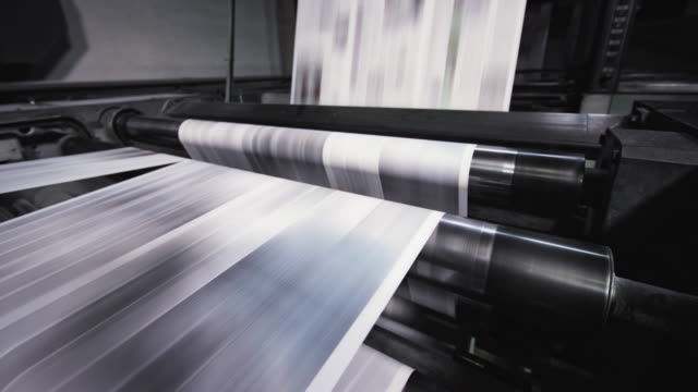 ld paper sheet moving fast through the machine in the newspaper printing factory - printing plant stock videos & royalty-free footage