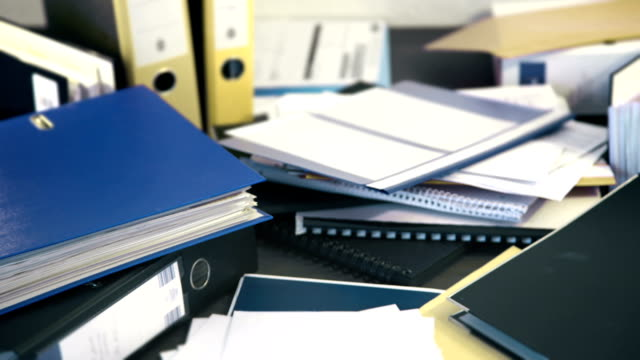 paper work piles up and gets worked off - desk stock videos & royalty-free footage