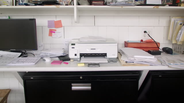 CU PAN Papers and printer and computer on desk in home office, Scarborough, New York, USA