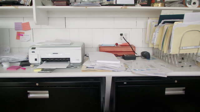 cu papers and printer on desk in home office, scarborough, new york, usa - disordinato video stock e b–roll